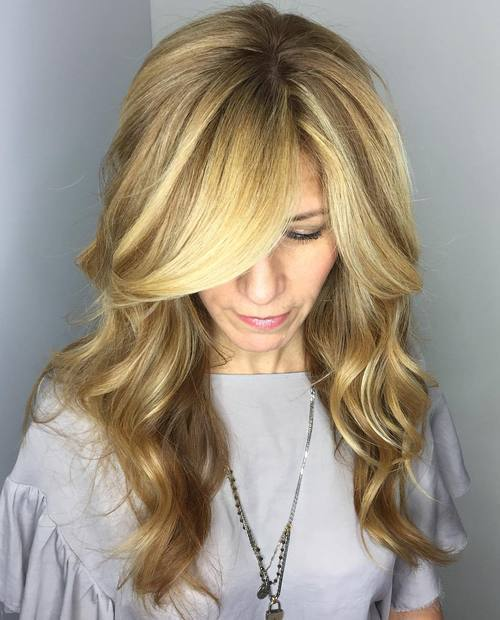 7-long-wavy-blonde-hairstyle-with-side-bangs 28 Cute Hairstyles for Oval Face Shape Girls These Days