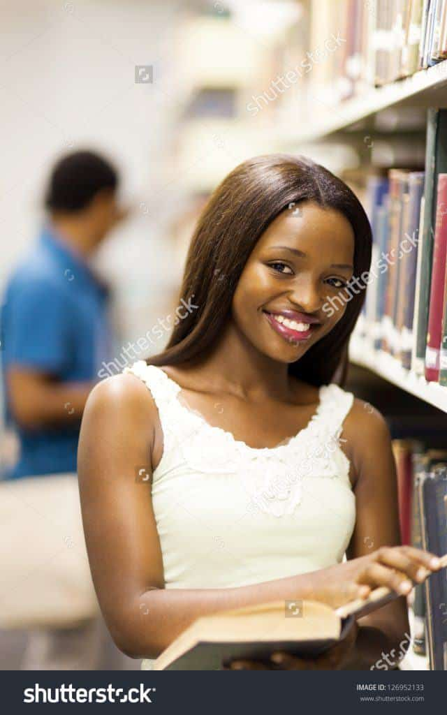 stock-photo-cute-african-american-college-girl-reading-in-library-126952133-640x1024 50 Cutest Pictures of African Girls of All Ages