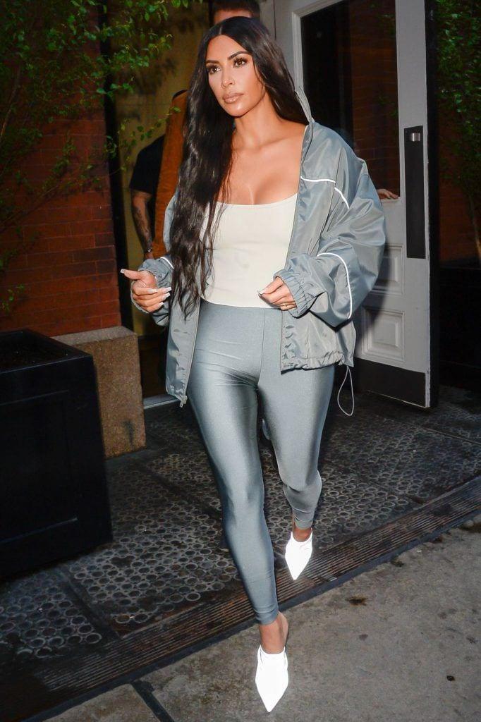 kim-kardashians-iconic-looks-10-682x1024 30 Most Stylish Kim Kardashian Outfits - Style Transformation