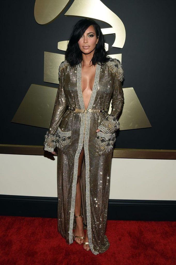 kim-kardashians-iconic-looks-3-681x1024 30 Most Stylish Kim Kardashian Outfits - Style Transformation