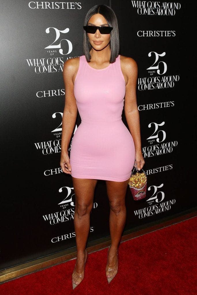 kim-kardashians-iconic-looks-9-683x1024 30 Most Stylish Kim Kardashian Outfits - Style Transformation