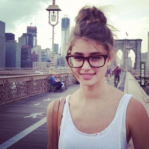 29-A-Messy-High-Up-Bun-For-Girls 37 Cute Hairstyles for Women with Glasses this Year