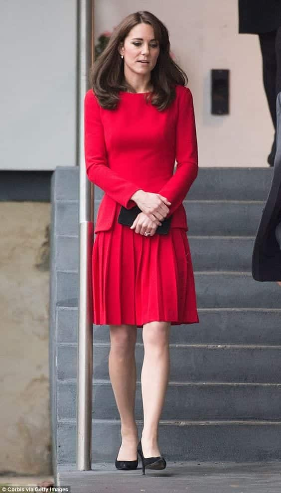Duchess-of-Cambridge-in-red-pleated-skirt Kate Middleton's Outfits-25 Best Dressing Styles Of Kate To Copy