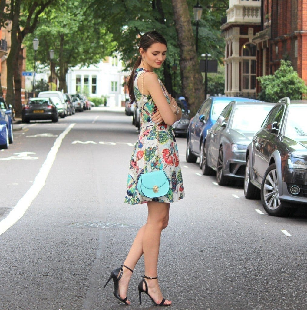 peexo-fashion-blogger-wearing-floral-print-dress-and-mini-mint-blue-bag-and-strappy-heels-1014x1024 Best Outfits to go with Tiny Bags-20 Ideas on How to Wear Mini Bags