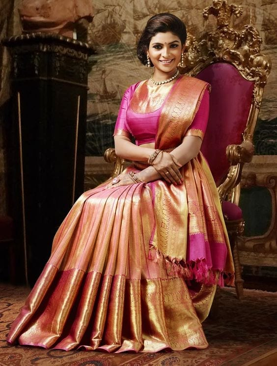 luxurious-pink-and-gold-south-indian-brand 23 Latest Indian Wedding Saree Styles to Try this Year