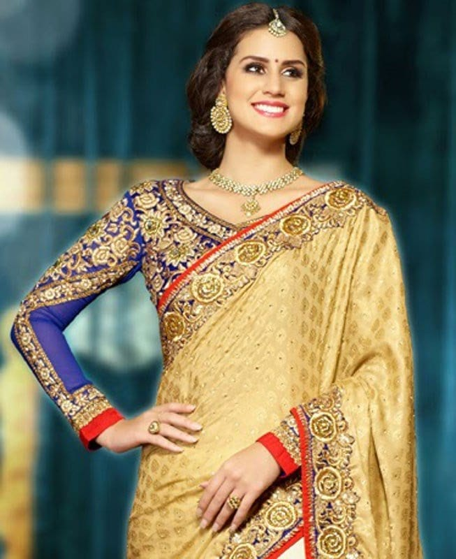 south-indian-majesty-gold-color-ivory-red-wedding-saree 23 Latest Indian Wedding Saree Styles to Try this Year
