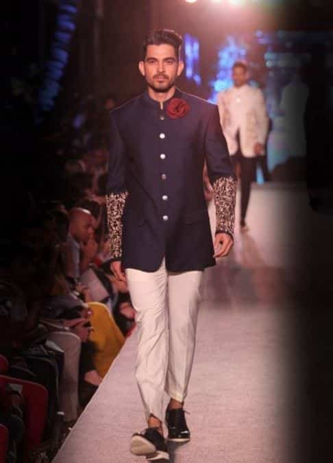 manish-malhotra-navy-embroidery-jacket-white-pants-gold Engagement Outfits for Indian Men-20 Latest Ideas what to Wear on Engagement