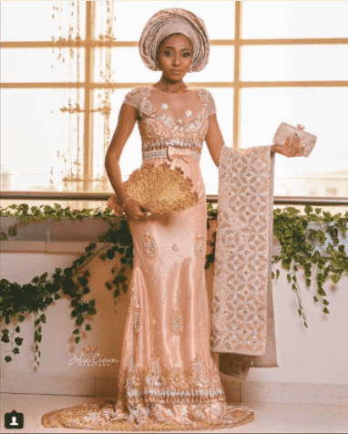 intricate-silk-gown 30 Latest Nigerian Dresses for Nigerian Brides 2019