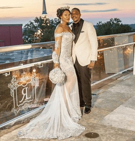 white-dress-with-a-sweeping-panel 30 Latest Nigerian Dresses for Nigerian Brides 2019