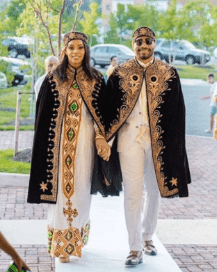 white-dress-with-gol-embroidered-cap 30 Latest Nigerian Dresses for Nigerian Brides 2019